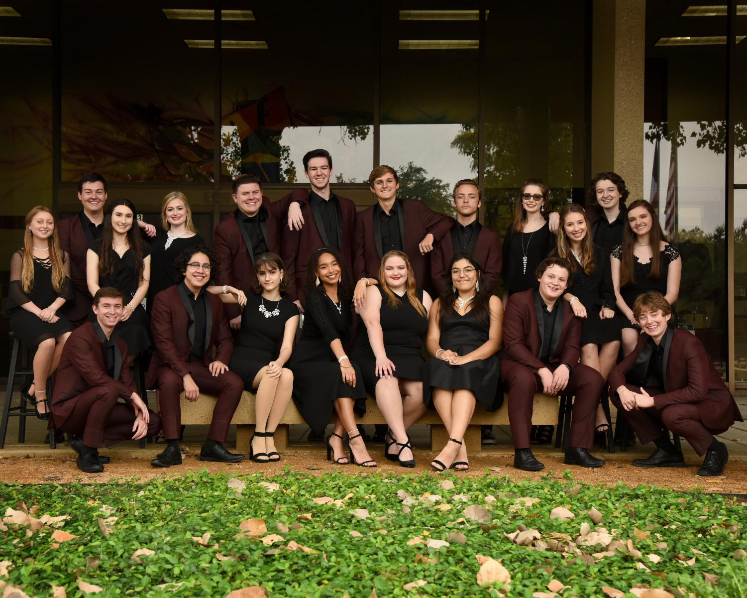 Music Corporation posing in their fancy attire to promote their jazz concert.