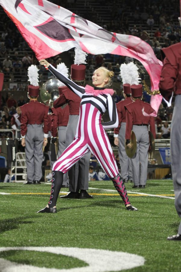 Captain Laura Anderson participating in the halftime show at the Pink out game.