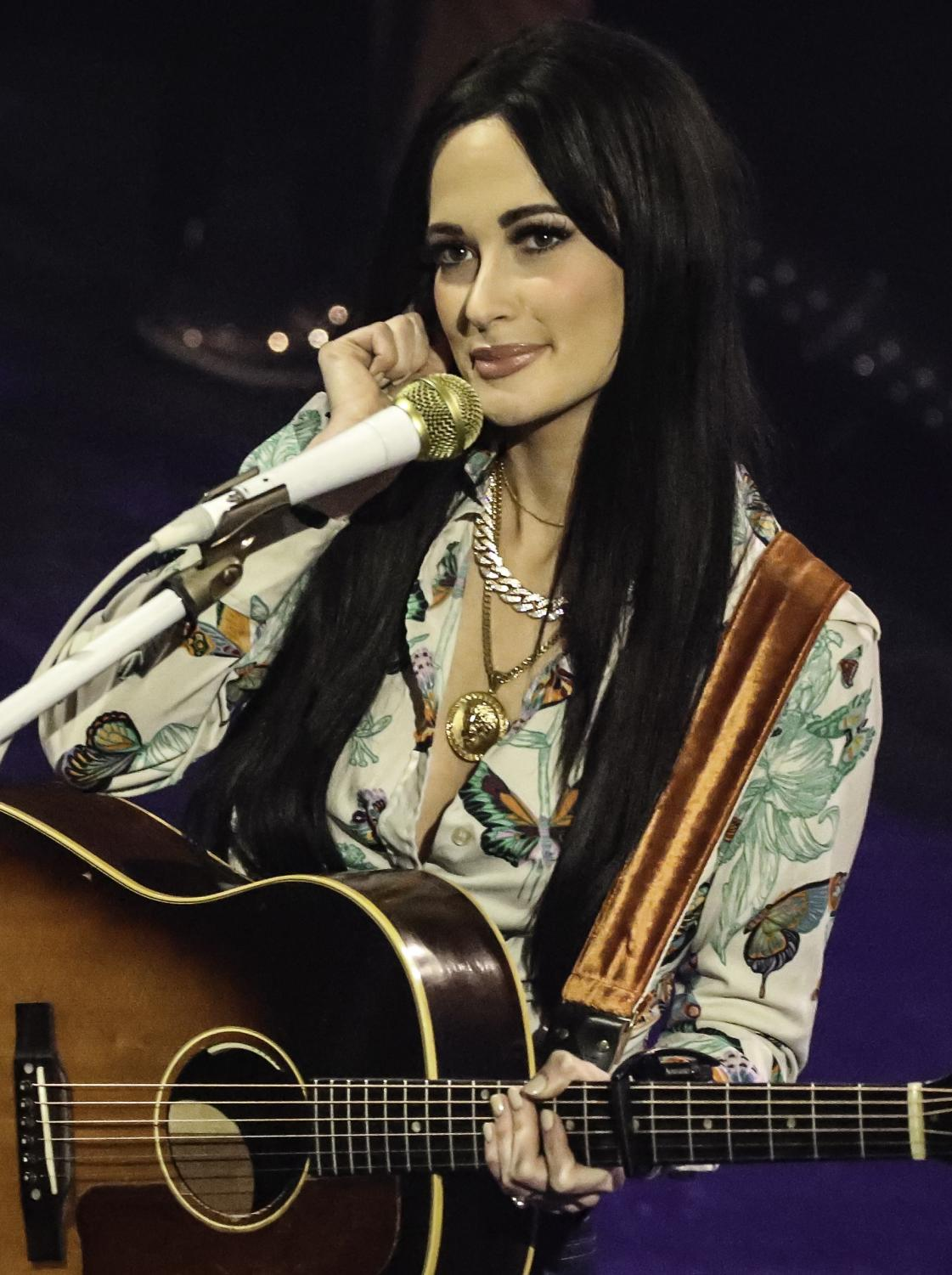 Kacey Musgraves performing a song at one of her many concerts.