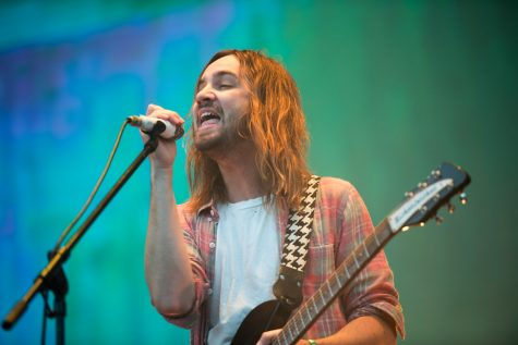 Lead singer Kevin Parker and band enamours audience at a music festival.