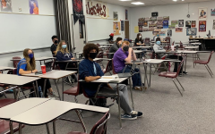 Students wear masks and social-distance while in the classroom.