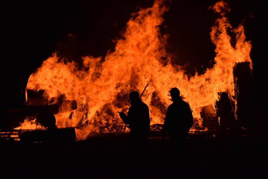 Firefighters walking near fire